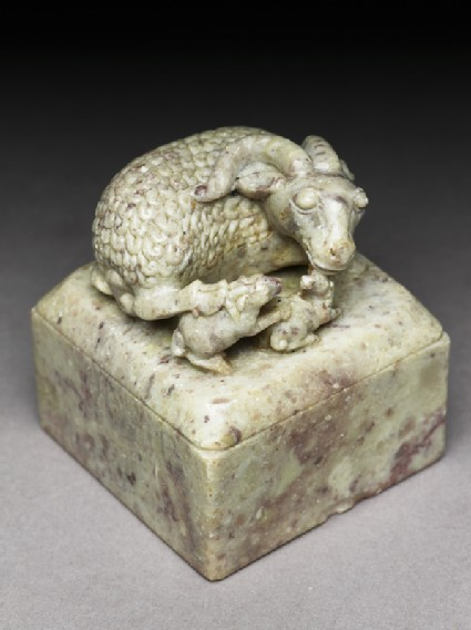 Soapstone seal surmounted by a ram and two lambs