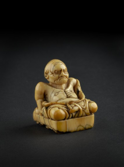 Netsuke in the form of a Buddhist ascetic on a seal base