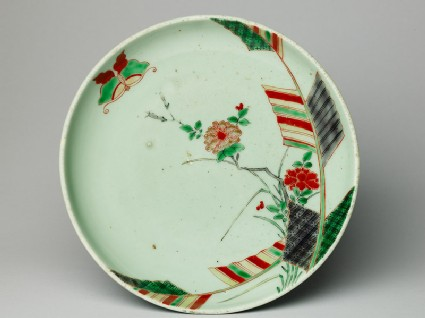 Dish with a butterfly and peony spray