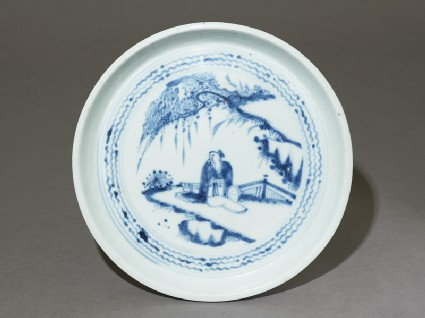 Blue-and-white dish with a figure in a landscape