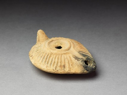 Oil lamp with moulded decoration