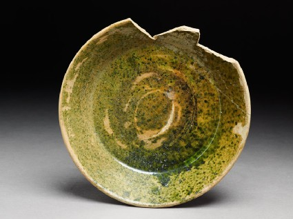 Fragment of a bowl with green glaze