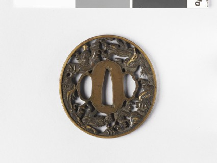 Round tsuba with two coiled dragons amongst clouds