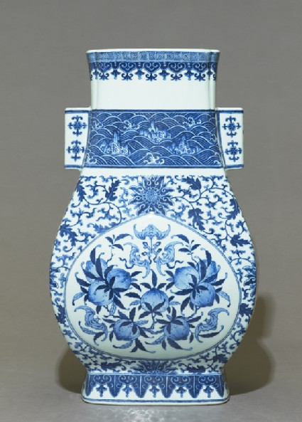 Blue-and-white vase with fruit and leaves
