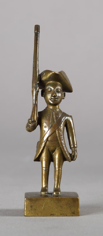 Toy European infantryman with tricorn hat and rifle