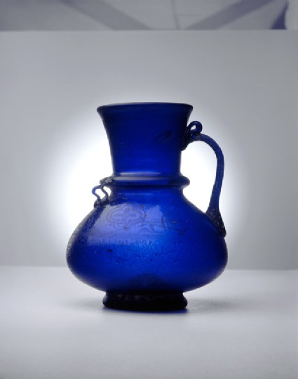 Blue glass jug with naskhi inscription
