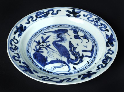 Blue-and-white plate with a phoenix