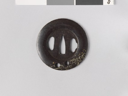 Round tsuba with design of waves