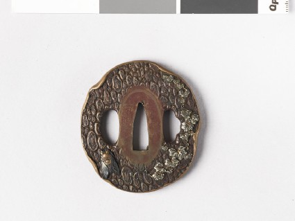 Round tsuba with design of tree bark, cicada and vines