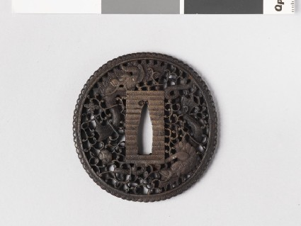 Round tsuba with design of dragons amid clouds