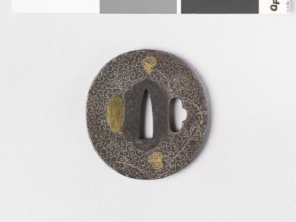 Round tsuba with design of scrolls, tendrils and leaves
