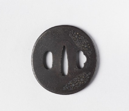 Round tsuba with design of tendrils and snowflakes