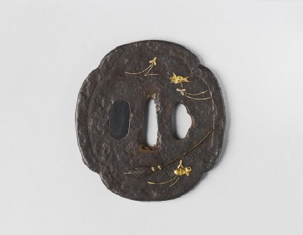 Mokkō-shaped tsuba with design of a broom, maple leaf, pine needles, and acorns
