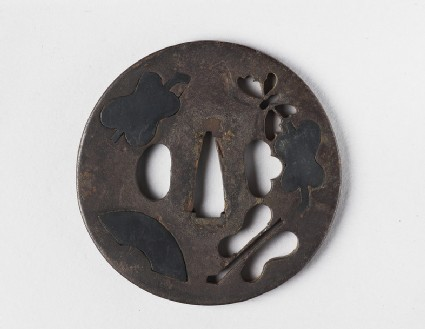 Round tsuba with design of fans and a butterfly
