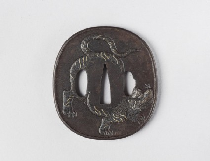 Round tsuba with design of tiger and bamboo