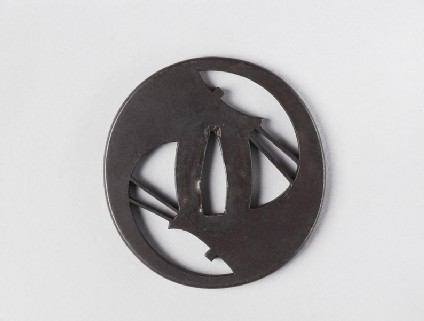 Round tsuba with stylised design of ship sails