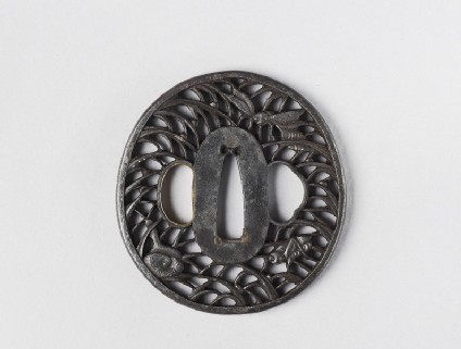 Round tsuba with design of insects and a snail in grass