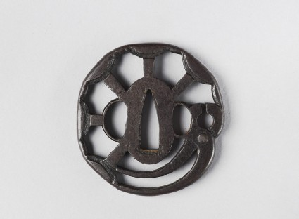 Round tsuba with design of anvils and smith's tongs