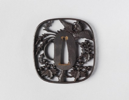 Round tsuba with design of paulownia branches and a phoenix