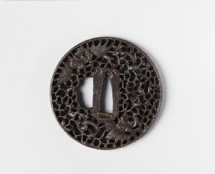 Round tsuba with design of clouds and winged dragons
