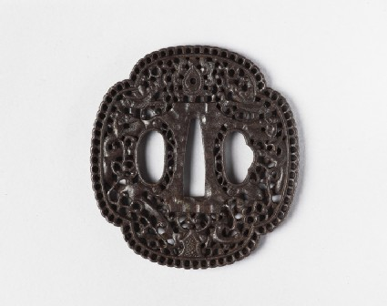 Mokkō-shaped tsuba with design of dragons, tama (sacred jewel) and scrollwork