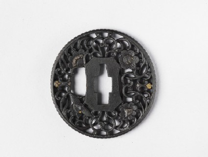 Round tsuba with design of tendrils and blossoms