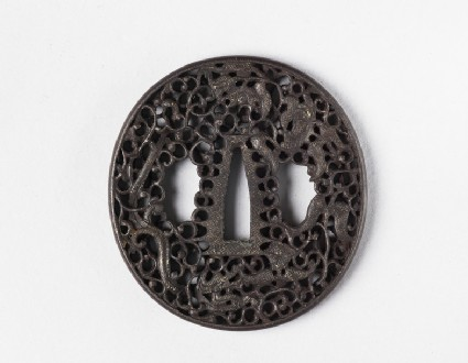 Round tsuba with design of dragons, blossoms and scrollwork