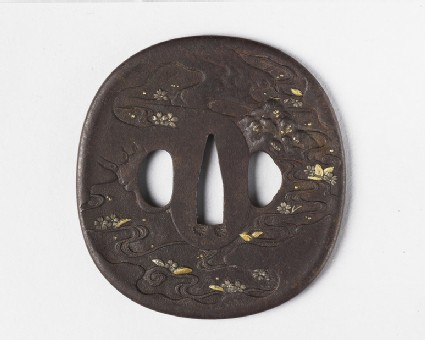 Round tsuba with design of cherry blossoms floating in a stream