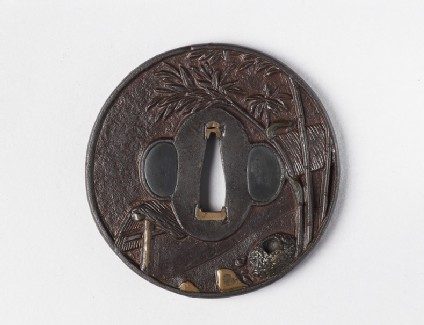 Round tsuba with design of bamboo and a teahouse