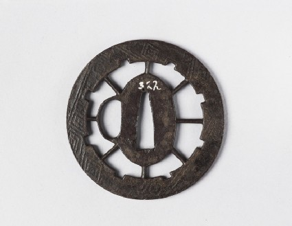 Round tsuba with design of a wheel