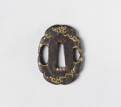 Lobed mokko-shaped tsuba with design of scrolls and tendrils