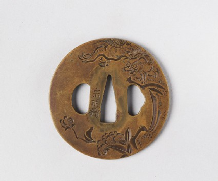 Round tsuba with design of a Shishi, peonies and foliage