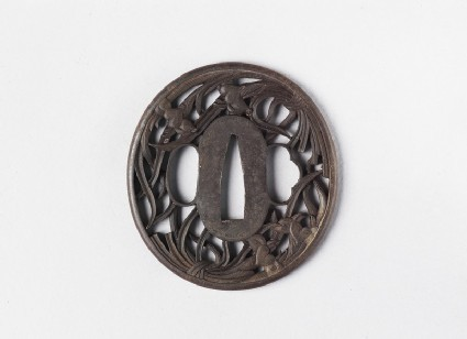 Round tsuba with design of two bunches of irises