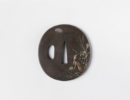 Round tsuba with design of the moon, a dog and grass