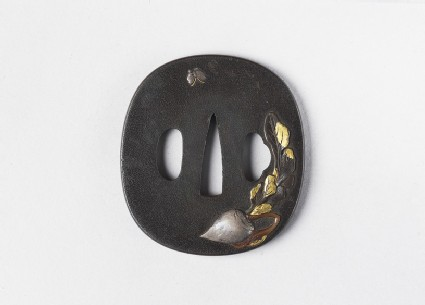 Round tsuba with design of daikon and a butterfly