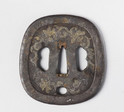 Round tsuba with design of flowers and tendrils