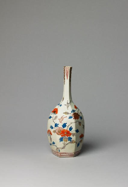 Bottle with flowers and birds
