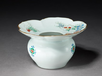 Spittoon with flowering plants and butterflies