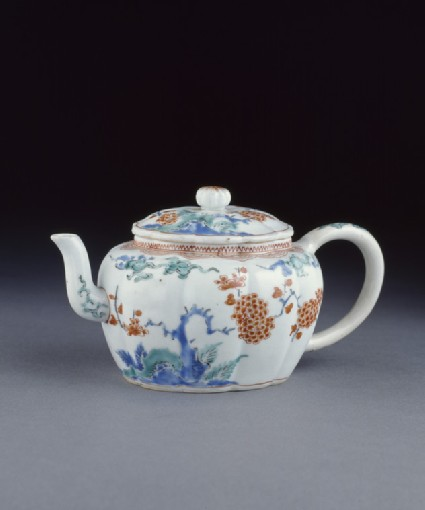 Tea pot with prunus, rocks and cloud scrolls
