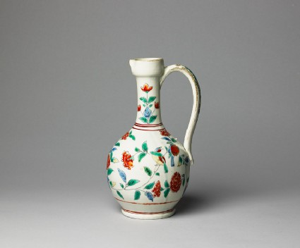 Jug with formal flower sprays and birds
