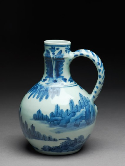 Mug with two figures in a landscape