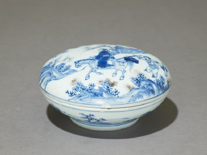 Blue-and-white ink box with man riding a horse