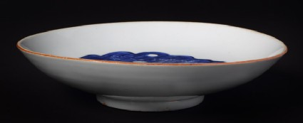 Blue-and-white dish with leaf and rock