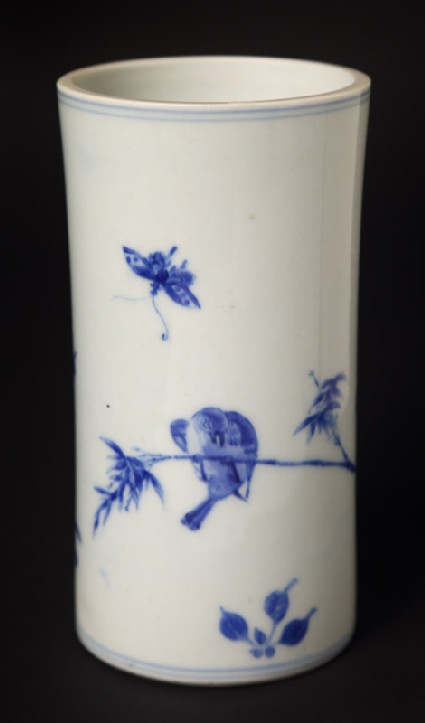 Blue-and-white brush pot with butterfly and bird on a branch