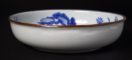 Blue-and-white basin with mythical figure and tiger