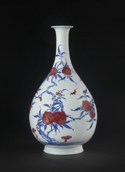Bottle with peach tree and flying bats