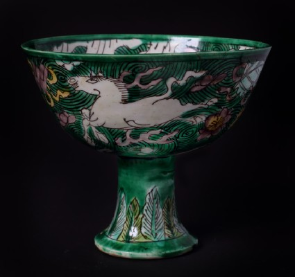 Stem cup with horses amid waves