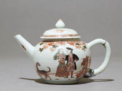Teapot depicting a couple with a dog