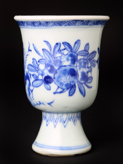 Blue-and-white stem cup with pomegranates and bamboo