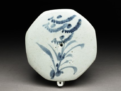 Blue-and-white water-dropper with foliage spray